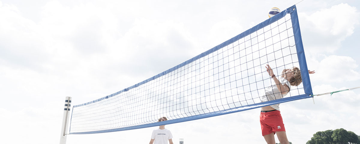 Image of young men playing volley ball. Click the image to enter the men's campaign called Under the Sun.