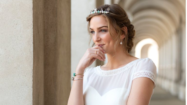 Bride smiling wearing Tiara and bracelet