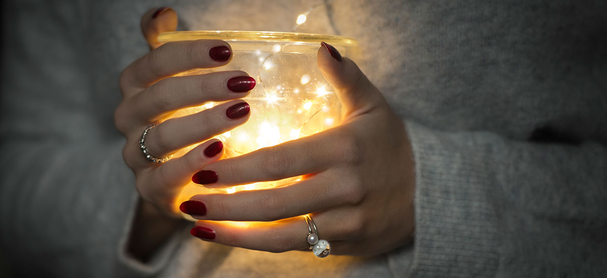 Hands with a candle and rings