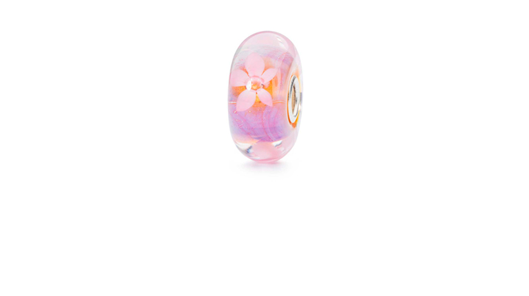 Sea Anemone glass bead in a pale swirling purple with delicate anemone flowers