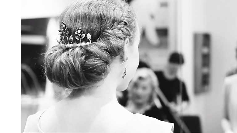 Tiara shown in a bun from the back