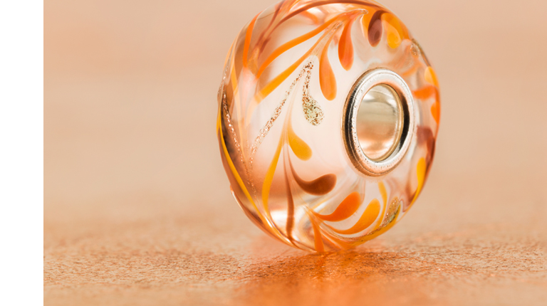 Close-up of the beautiful Joy glass bead that sparkles in the light