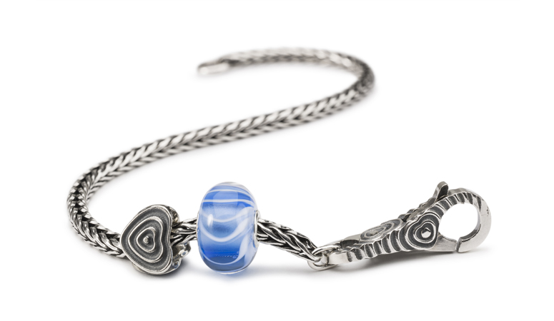 Sterling silver bracelet with silver heart bead, lock and gracefull glass bead.