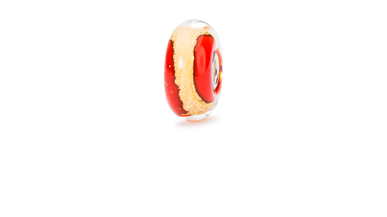 The Root Chakra bead stands out with its red glass core and the 22 karat gold swirling just inside the clear glass