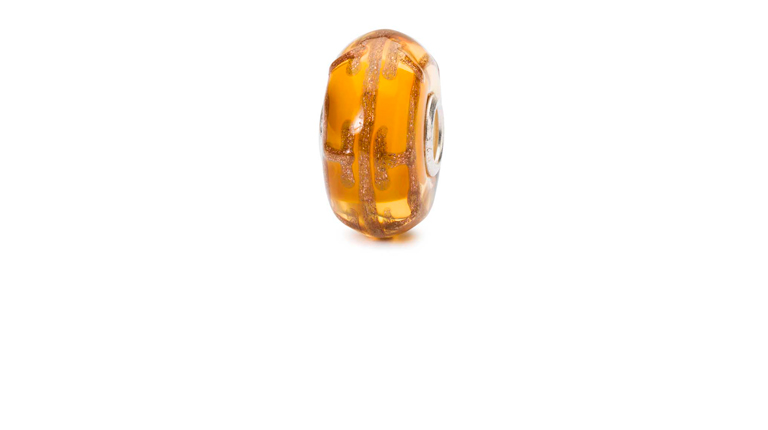 The Dream Blaze is a yellow glass bead with a sparkling copper pattern