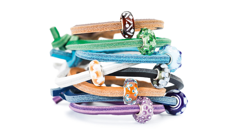 Stack of leather jewellery bracelets with Unique beads in vibrant colours
