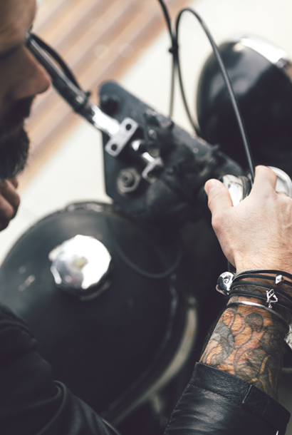 Mens bracelet on tatooed man on bike