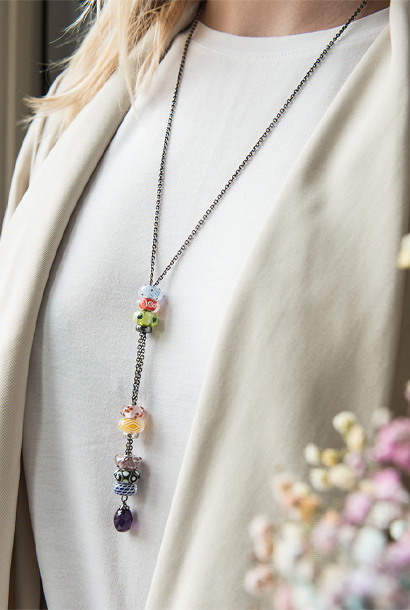 Long fanatsy necklace with various glass beads