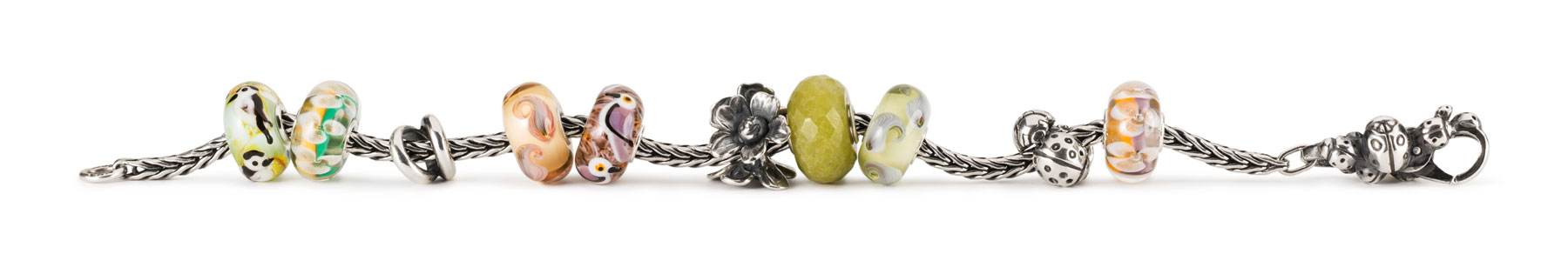 Silver bracelet adorned with the new beads from the Autumn collection