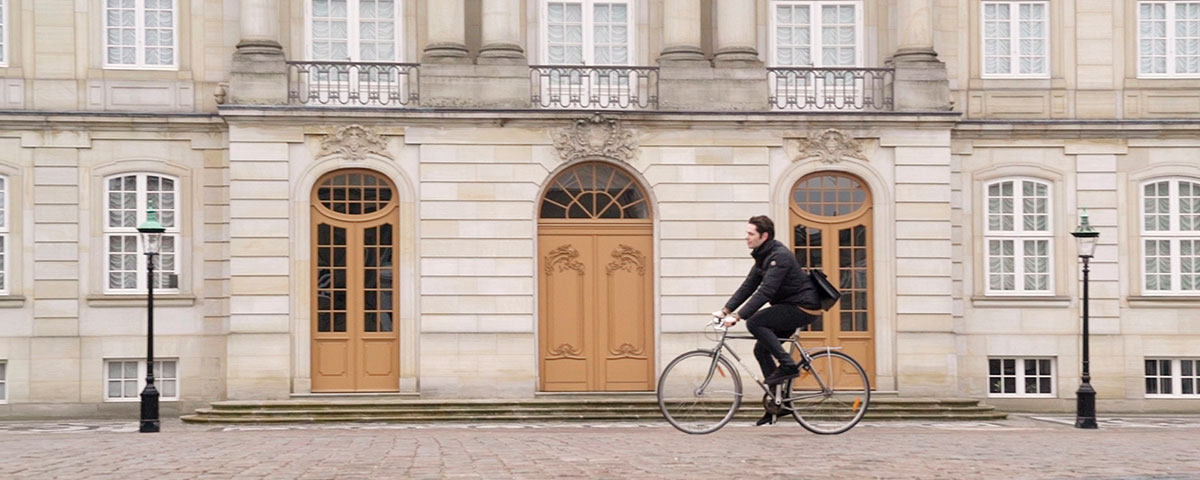 Image of man biking and exploring the city
