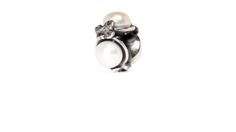 Triple Pearl, White is a combination of sterling silver and three white pearls