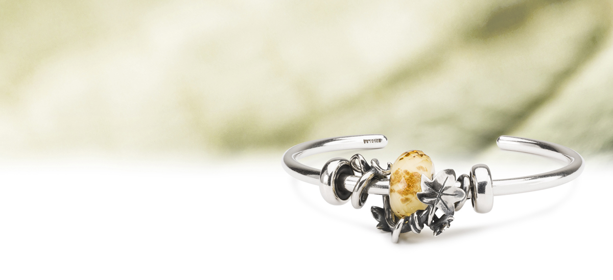 The winner of Trollbeads People's Bead 2020 event is Amanda White with the beautiful bead, Framed by Ivy